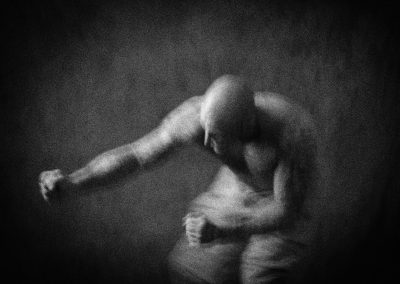 black and white, grainy study of martial art practice moves